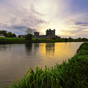 River with castle ruins in background
