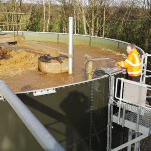 Wastewater Treatment Plant being monitored by man in HiVis jacket
