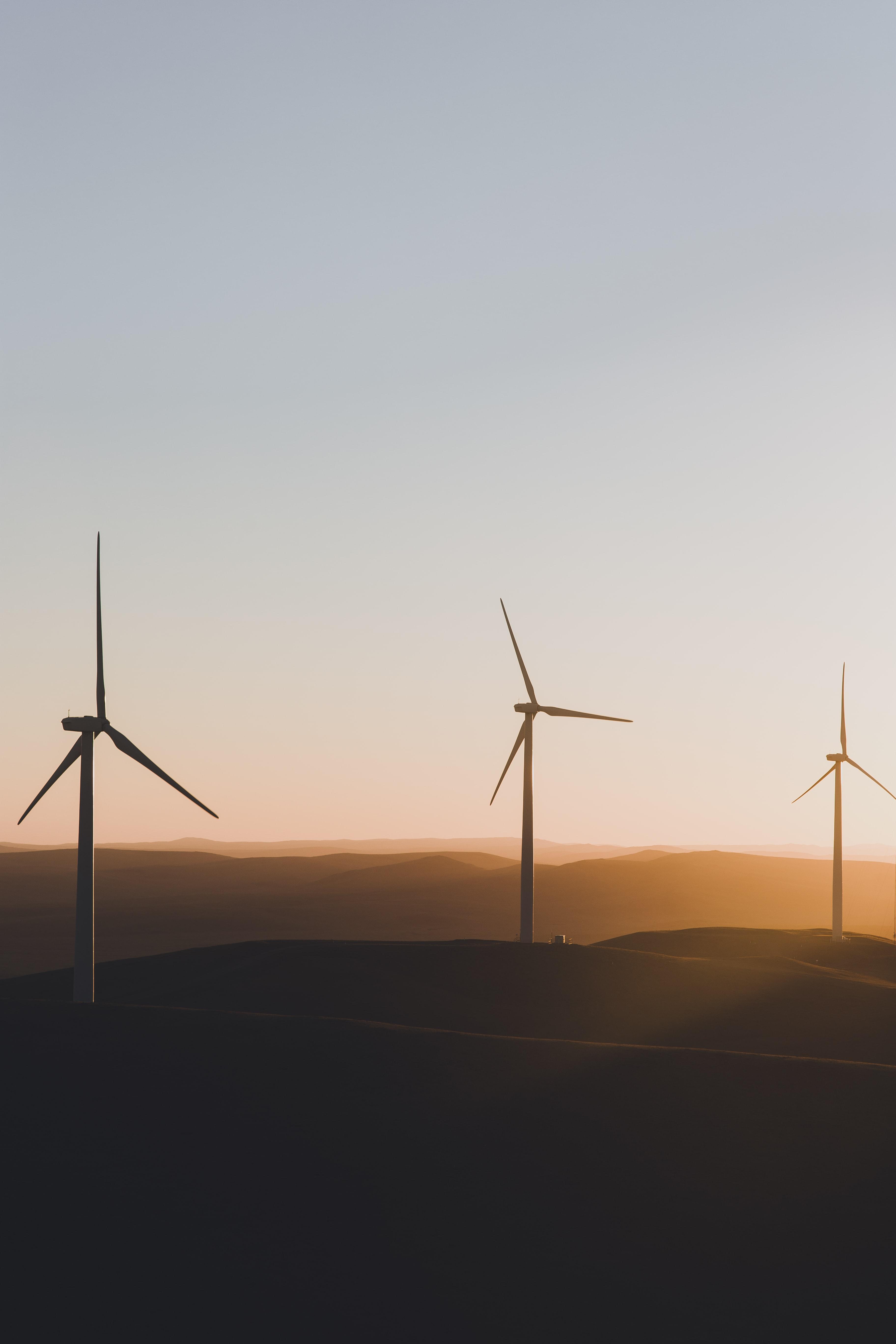 3 Wind turbines at sunset